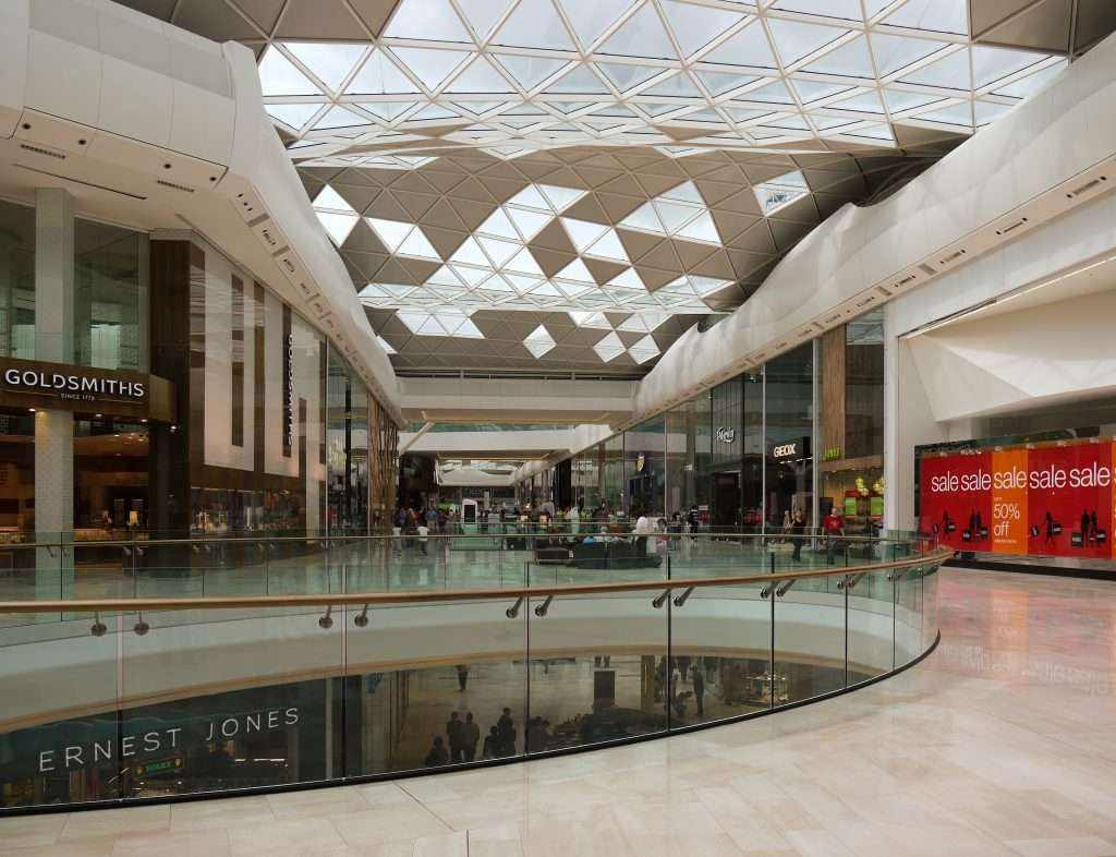 Shopping centres generate high levels of noise. Control the acoustics in retail environments by utilising sound absorbent materials