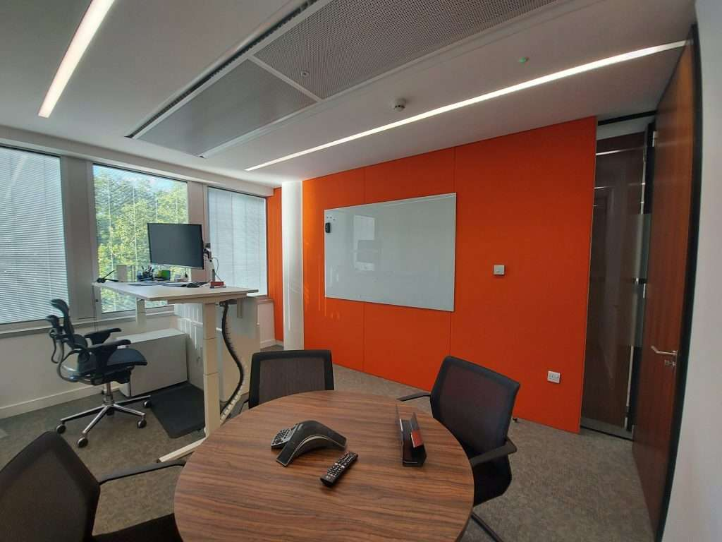 A picture of orange acoustic wall panel in london-based law firm
